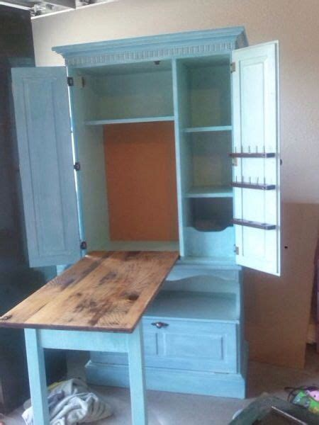 craft armoire with fold out table repurposed armoire sewing cabinet fold table top legs