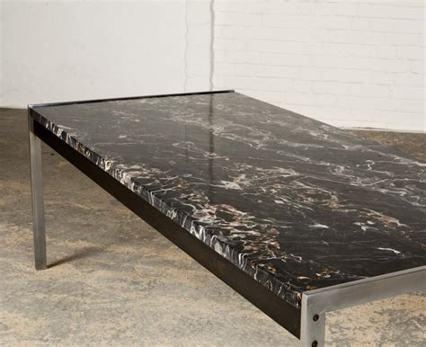 black marble and brushed steel coffee table by kho liangh