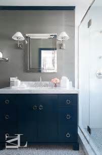 navy blue and gray bathroom features walls clad in grey