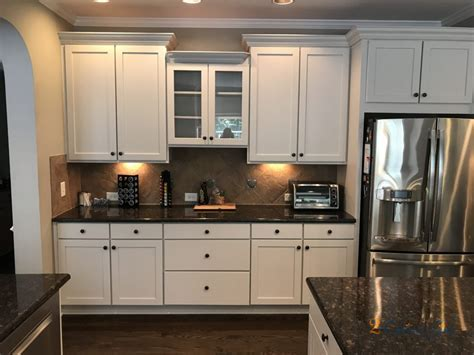 Balboa Mist Painted Kitchen Cabinets & Laundry Room in