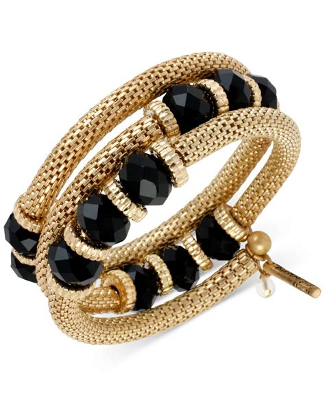 kenneth cole gold tone black faceted bead coil bracelet in