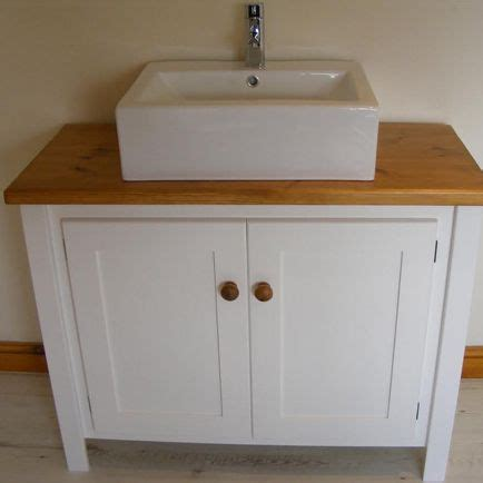 white vanity unit  traditional top  countertop sink