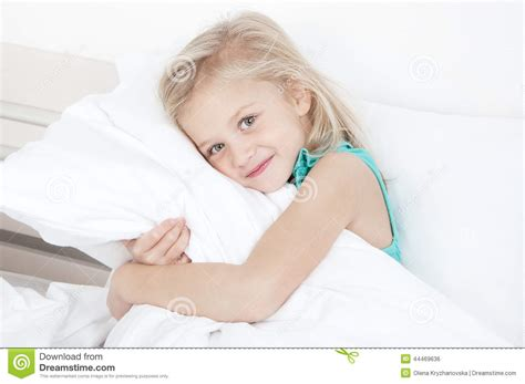 When Should Toddler A Pillow by Adorable Looking At The Stock Photo
