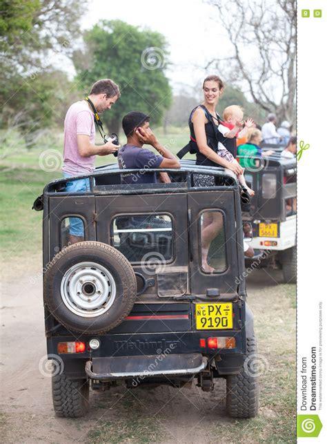 jeep family sri lanka family sitting on the beach at batticaloa sri