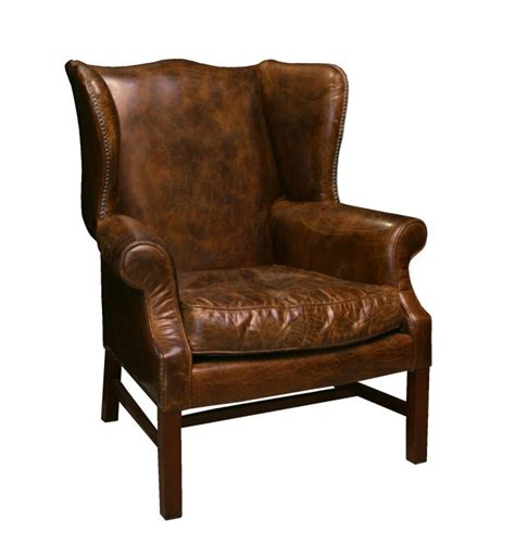 Impressive Distressed Leather Wing Back Chair at 1stdibs