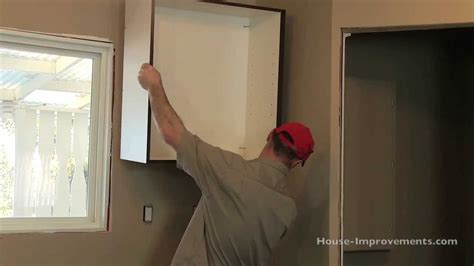 how to hang a kitchen cabinet how to install kitchen cabinets youtube