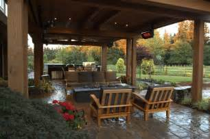 gorgeous covered stone patio with heaters gas fire pit