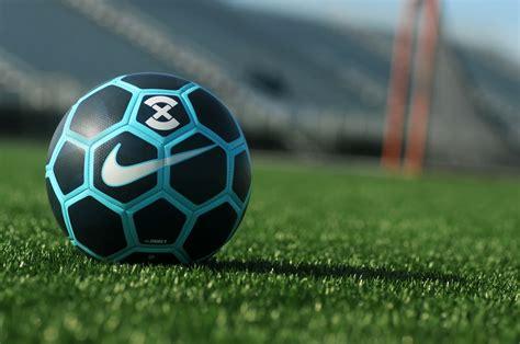 black blue  white soccer ball  grass field photo