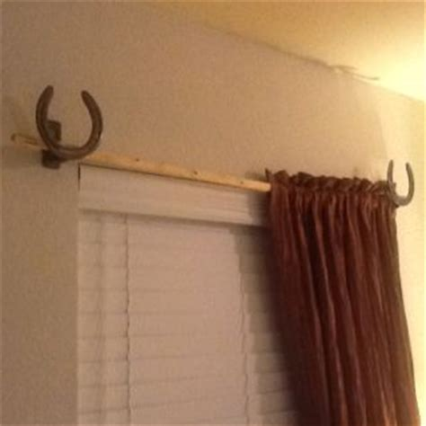 horse curtain rod horseshoe curtain rod holders with a small tree cut for