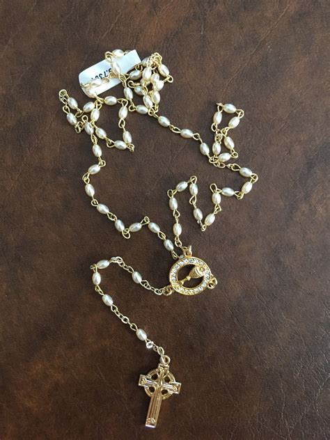 celtic cross with rosary white and gold beaded rosary with celtic cross s