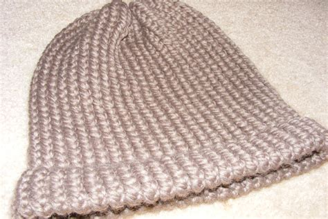 knitting hat on loom 301 moved permanently