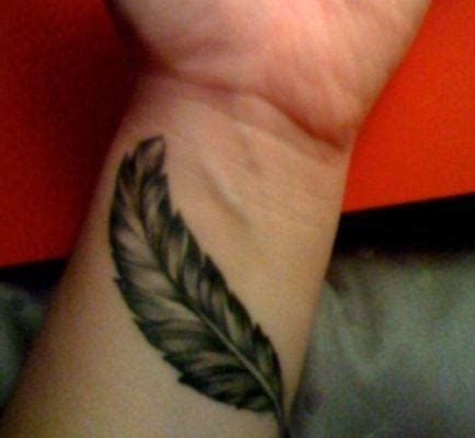 wrist tattoo feather 25 designs feather tattoos