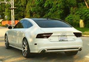 white audi a7 with custom rims near brickell ave