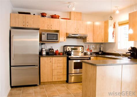 kitchen images with stainless steel appliances baltic brown kitchen with cherry cabinets and white