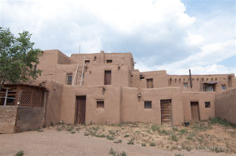 Adobe Pueblo Houses by Taos Pueblo And A Thousand Year Old Adobe Architecture