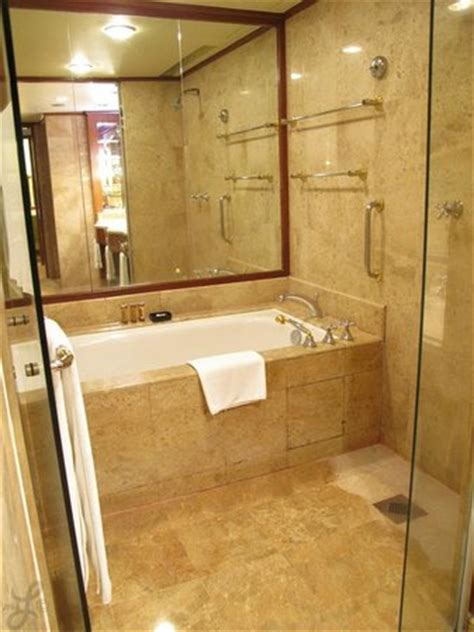2 bedroom hotel kuala lumpur the main bathroom connected to the bedroom has a bathtub and two shower heads