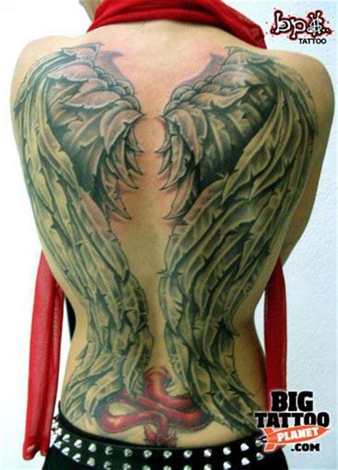 tattoo black and green olive green black and grey tattoo big tattoo planet
