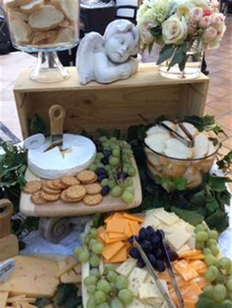creative bridal shower appetizers tiered stand to display assorted cheese cubes and crackers for a summer wedding reception hi lo