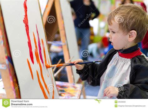 preschool painting free kid painting at preschool stock photo image of learning