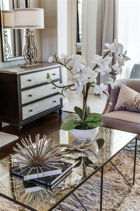 Living Room Table Accessories Check Out The Stylish Mercury Glass Coffee Table In This Transitional Living Room On Hgtv