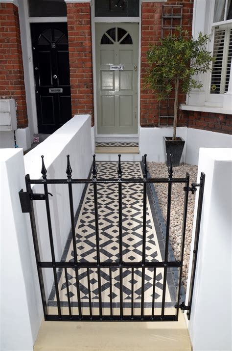 front garden wall painted white metal wrought iron rail