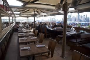 best rooftop restaurants enjoy mile high meals at the best rooftop restaurants in nyc