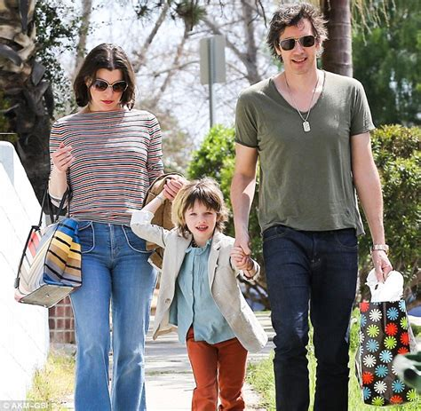 milla jovovich dad milla jovovich heads to a birthday bash with her equally