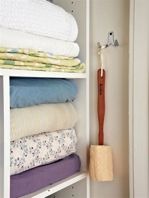 How To Organize Towels In A Closet by Organizing A Linen Closet Hgtv