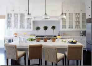 White kitchen the white dishware continues the all white scheme and