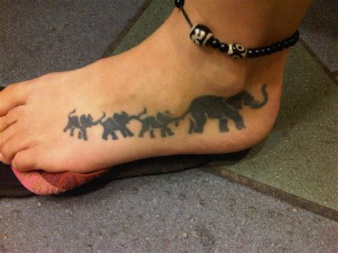 elephant tattoo trunk to tail this tattoo was inspired by the women s 3 children