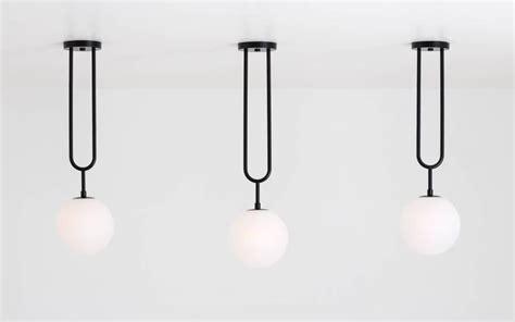 Koko Modern A koko modern pendant light with satin globe shade in