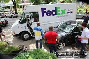 fedex driver loses smashes parked car