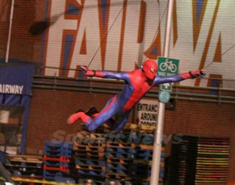 the amazing spider man swing new pics show the amazing spider man swinging through the air