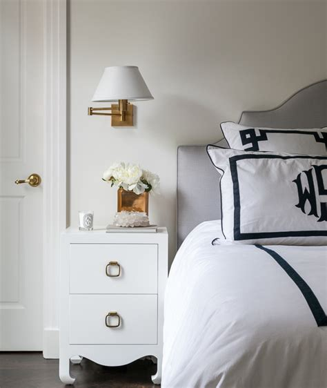 bedroom sconce gray bedroom with monogrammed shams and antique brass