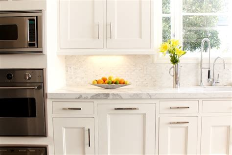 backsplashes for white kitchen cabinets mini marble backsplash transitional kitchen lonni