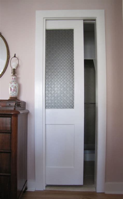 pocket door with glass would to switch out the bathroom door for a pocket door for the