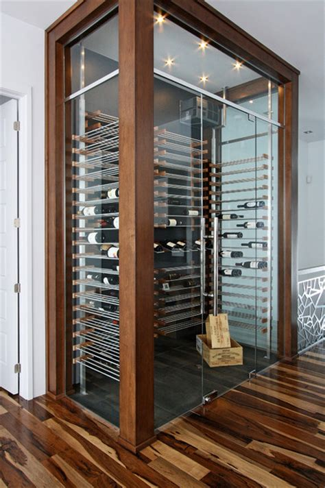 glass wine cellar   living room  contemporary wine cellar miami  millesime