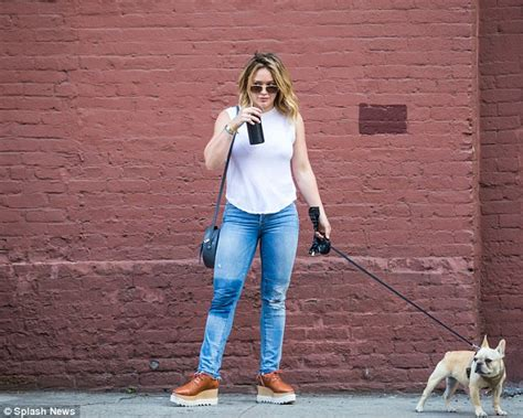 Hilary Duffs Dg Purse by Hilary Duff Takes For A Walk During A