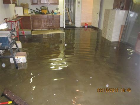 water heater flooded basement water damage and restorationrmc r