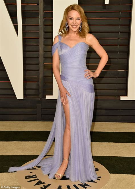 Minogues Looks Different by Minogue Flashes Glimpse Of Pert Derriere At Oscars