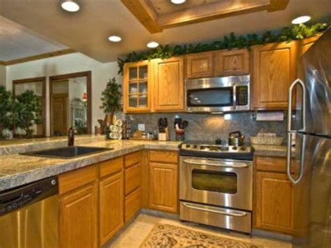 what color granite goes with honey oak cabinets granite and stainless appliances with oak cabinets