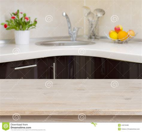 wallpapers background interior decoration of kitchen wooden table on kitchen faucet interior background stock