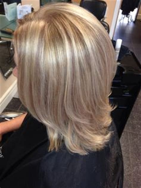 layred hairstyles eith high low lifhts three shades of blonde shoulder length layered bob my