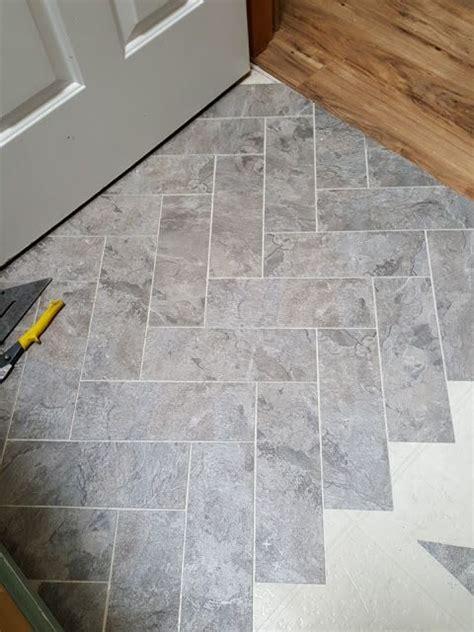 diy vinyl floor in herringbone pattern the rusty door