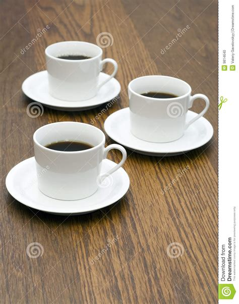 3 coffee cups on wood table stock photo image 9814640