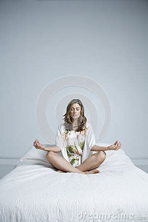 lotus position in bed meditating in lotus position on bed royalty free