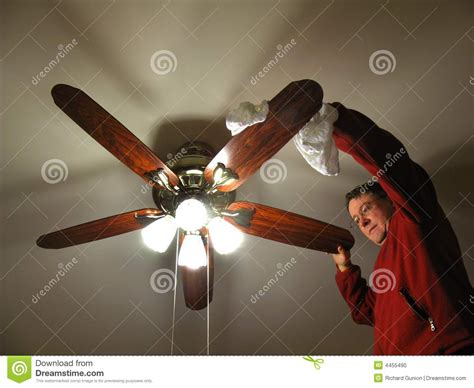 ceiling fan cleaning company cleaning the ceiling fan stock photo image of dust
