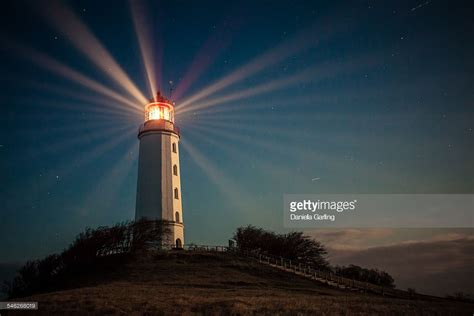 light house at lighthouse on a hill shining at stock photo getty