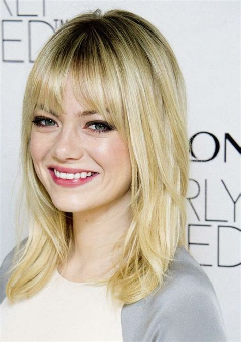 emma stone blonde hair emma stone medium length hair with long layers and bangs