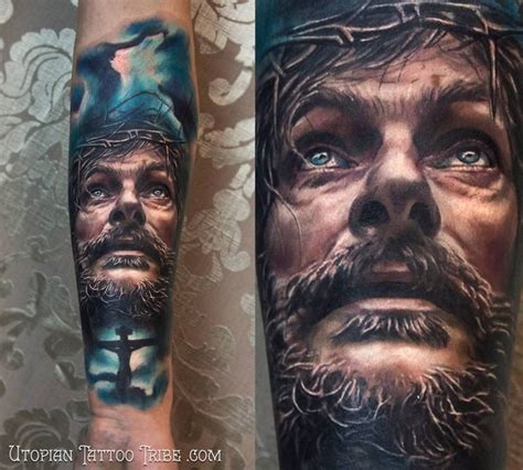 neo traditional style colored forearm tattoo of jesus face